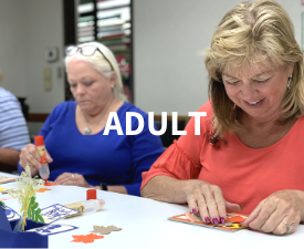 Adult patrons doing crafts