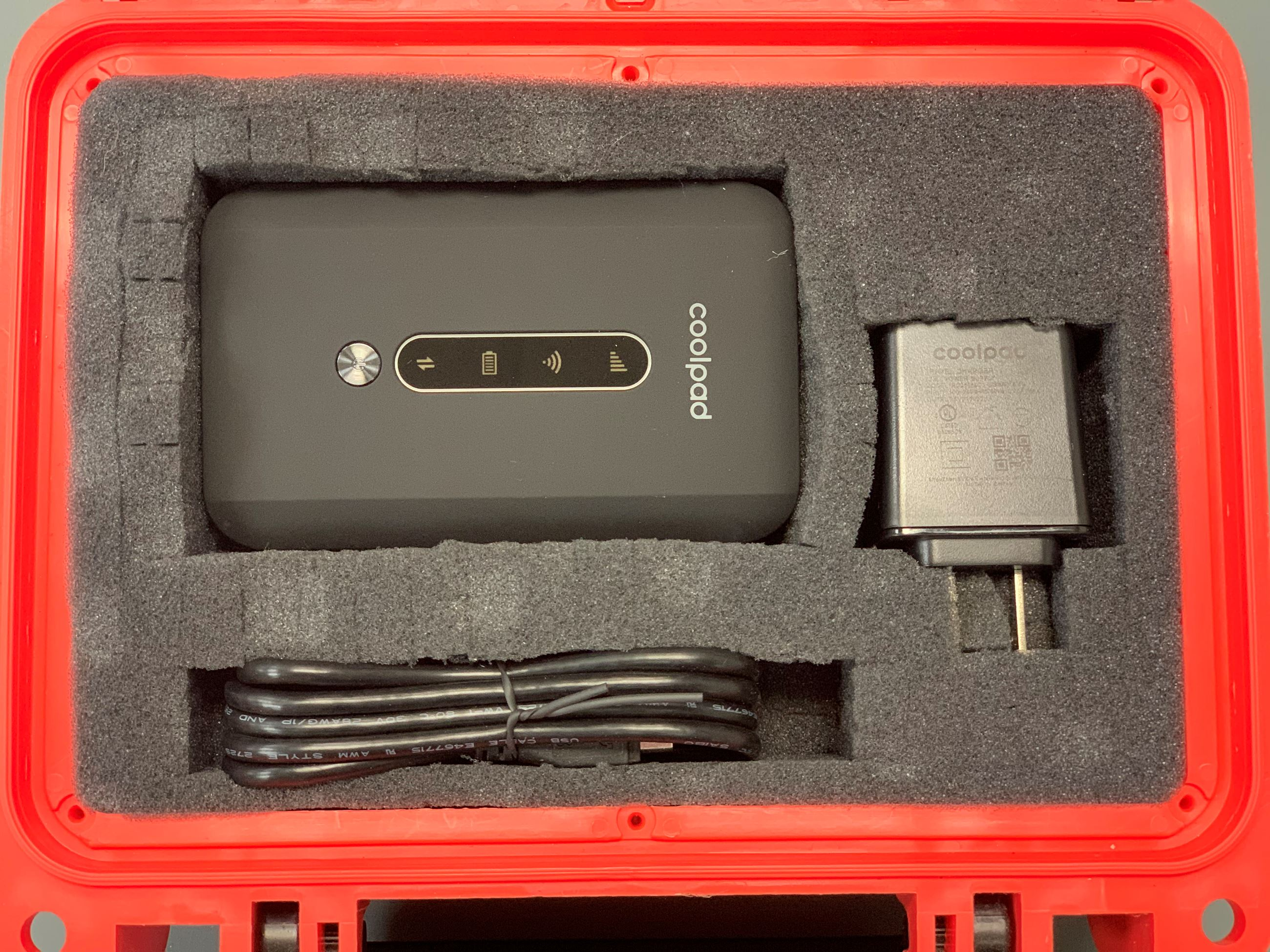 Mobile Beacon Hotspot in red case with charging cable